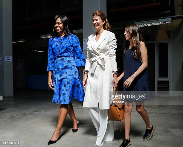 In this handout picture First Lady Michelle Obama and First Lady Juliana Awada walk prior a conference as part of Let Girls Talk Programme at Centro...
