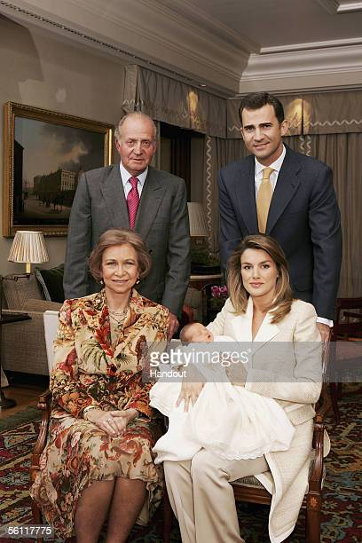 In this handout picture from the Casa Real, Princess Letizia holds her newborn daughter Princess Leonor with her husband Prince Felipe and his...