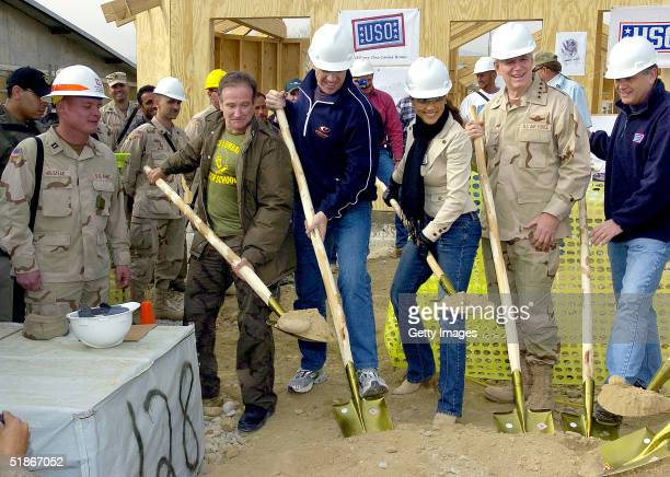 In this handout picture from the United Service Organizations USO President and CEO Ned Powell Chairman of the Joint Chiefs of Staff General Richard...