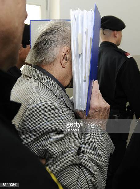 In this handout picture Josef Fritzl arrives at the country court of St Poelten on the beginning of his trial on March 16 2009 in St Poelten Austria...