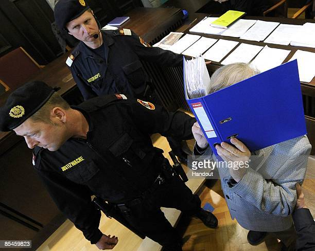In this handout picture Josef Fritzl covers his face as he arrives at the second day of his trial at the country court of St Poelten on March 17 2009...