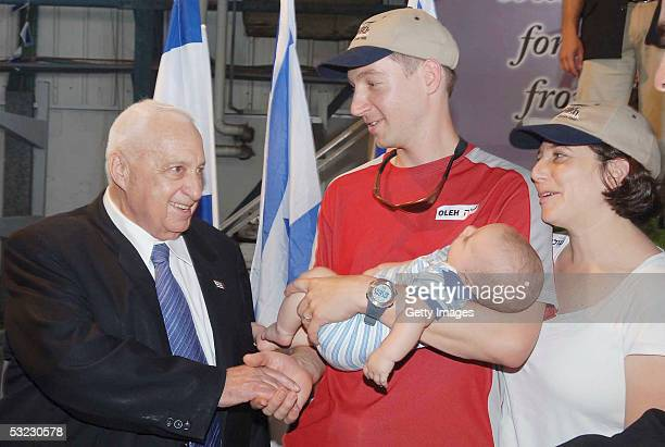 In this handout picture Prime Minister of Israel Ariel Sharon poses with new immigrants from North America to Israel at Ben Gurion airport on July...