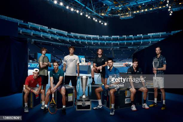 In this handout picture provided by ATP 2020 Nitto ATP Finals singles qualifiers from left to right: Diego Schwartzman of Argentina, Andrey Rublev of...
