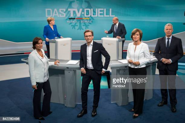 In this handout picture provided by German television channel ARD German Chancellor and Christian Democrat Angela Merkel and German Social Democrat...