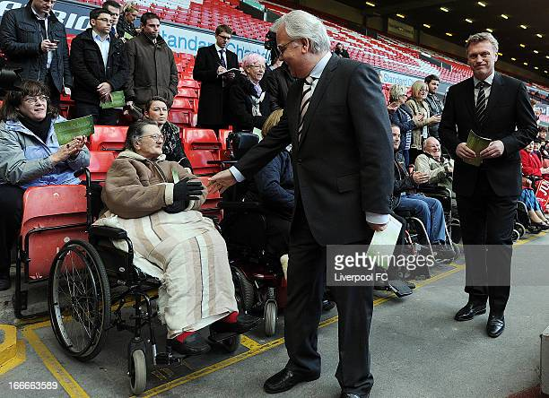 In this handout picture provided by Liverpool FC, Chairman Bill Kenwright and manager David Moyes of Everton greet supporter as he attends the 24th...