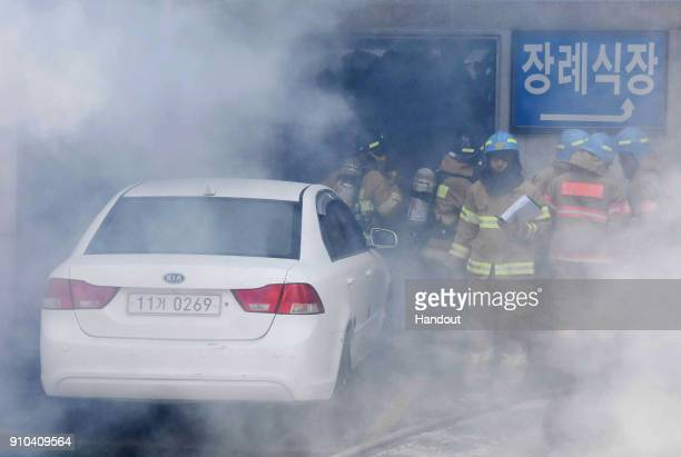 In this handout picture provided by the Kim Gu YeonGyeongnam Domin Ilbo The death toll more than 30 as rescue workers searched a scorched smokefilled...