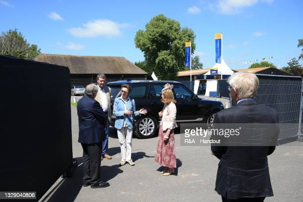 In this handout picture provided by the R&A, HRH The Princess Royal and Vice Admiral Sir Timothy Laurence arrive at The 149th Open at Royal St...
