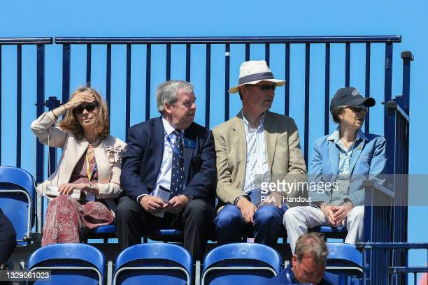 In this handout picture provided by the R&A, HRH The Princess Royal and Vice Admiral Sir Timothy Laurence watch the world's best men golfers...