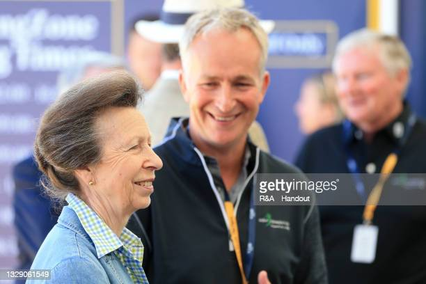 In this handout picture provided by the R&A, HRH The Princess Royal and Vice Admiral Sir Timothy Laurence call in at The R&A Swing Zone at The 149th...