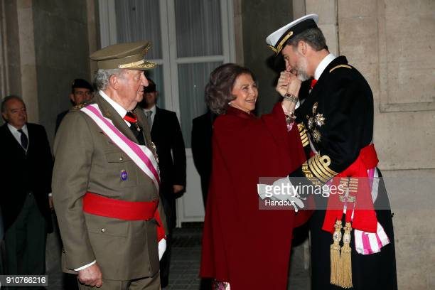 In this handout picture provided by the Spanish Royal House King Juan carlos Queen Sofia and King Felipe of Spain are seen during the Military Parade...