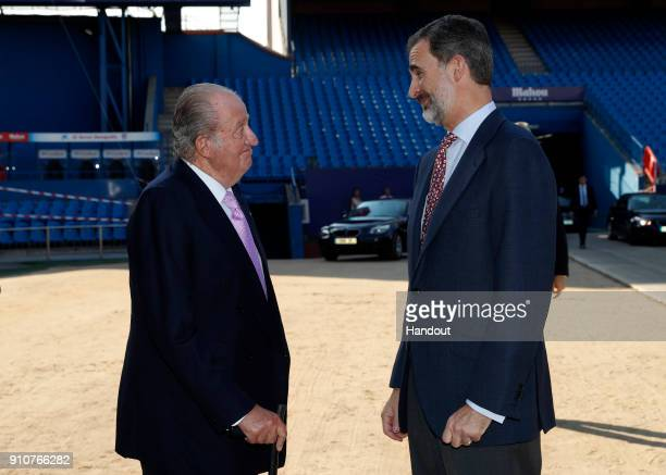 In this handout picture provided by the Spanish Royal House King Juan Carlos and King Felipe of Spain are seen during the presentation of COTEC...