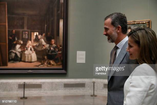 In this handout picture provided by the Spanish Royal House King Felipe of Spain and Queen Letizia of Spain are seen visiting the Prado Museum on...