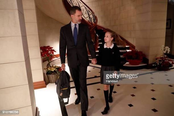 In this handout picture provided by the Spanish Royal House King Felipe of Spain and Princess Leonor are seen leaving Zarzuela Palace to go to school...
