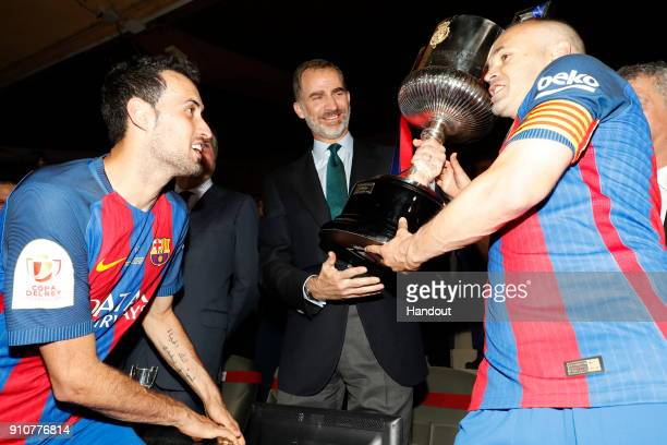 In this handout picture provided by the Spanish Royal House, King Felipe of Spain and Andres Iniesta are seen celebrating that Barcelona FC won the...