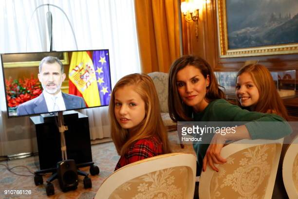In this handout picture provided by the Spanish Royal House Princess Leonor Queen Letizia of Spain and Princess Sofia are seen watching the Christmas...