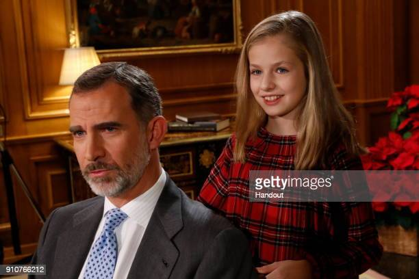 In this handout picture provided by the Spanish Royal House Princess Leonor and King Felipe of Spain are seen during the Christmas recording message...