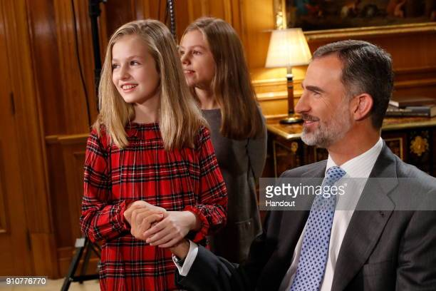In this handout picture provided by the Spanish Royal House Princess Leonor and princess Sofia are seen with King Felipe of Spain during the...