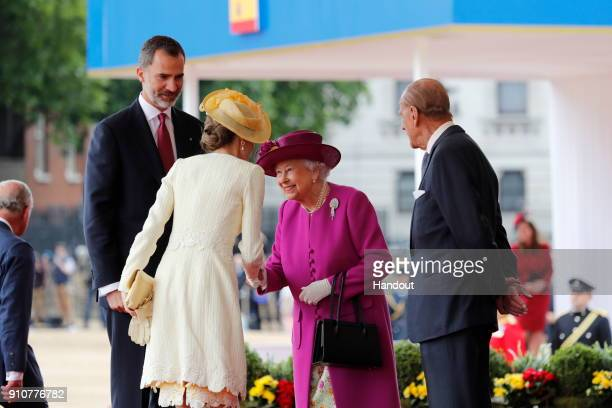 In this handout picture provided by the Spanish Royal House Queen Elisabeth II and Prince Philip Duke of Edimburgh greet King Felipe of Spain and...