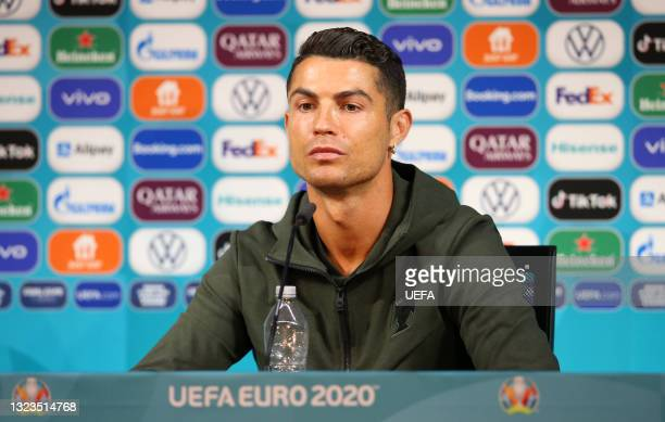 In this Handout picture provided by UEFA, Cristiano Ronaldo of Portugal speaks to the media during the Portugal Press Conference ahead of the Euro...
