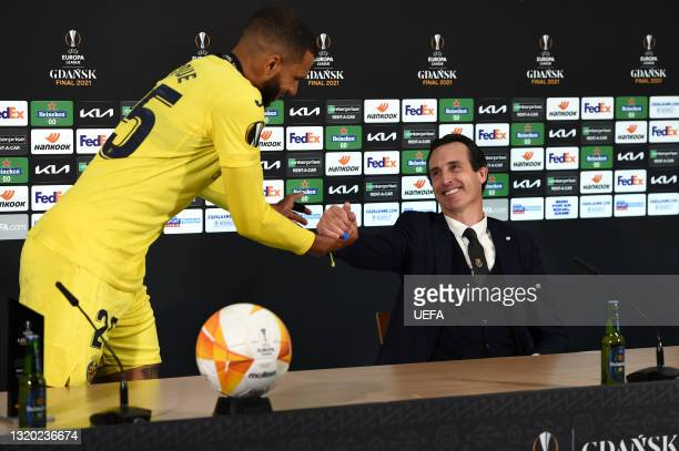 In this Handout picture provided by UEFA, Etienne Capoue of Villarreal CF interacts with Unai Emery, Head Coach of Villarreal CF during a Press...
