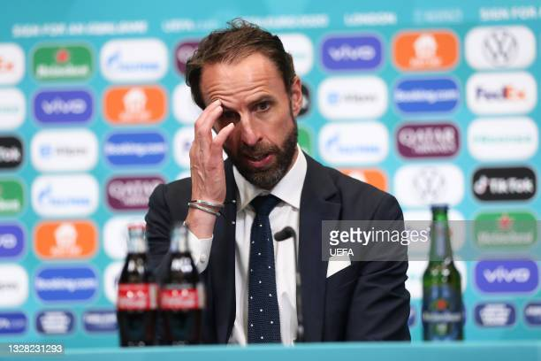 In this handout picture provided by UEFA, Gareth Southgate, Head Coach of England reacts as he speaks to the media during the England Press...
