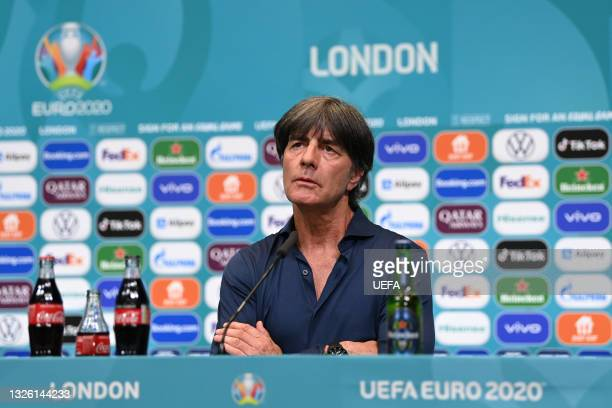 In this handout picture provided by UEFA, Joachim Loew, Head Coach of Germany reacts as he speaks to the media during the Germany Press Conference...