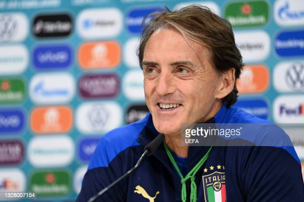 In this handout picture provided by UEFA, Roberto Mancini, Head Coach of Italy reacts as he speaks to the media during the Italy Press Conference...