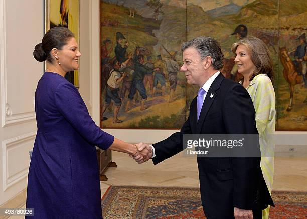 In this handout picture released by Presidencia de la Republica de Colombia, President of Colombia Juan Manuel Santos greets Crown Princess Victoria...