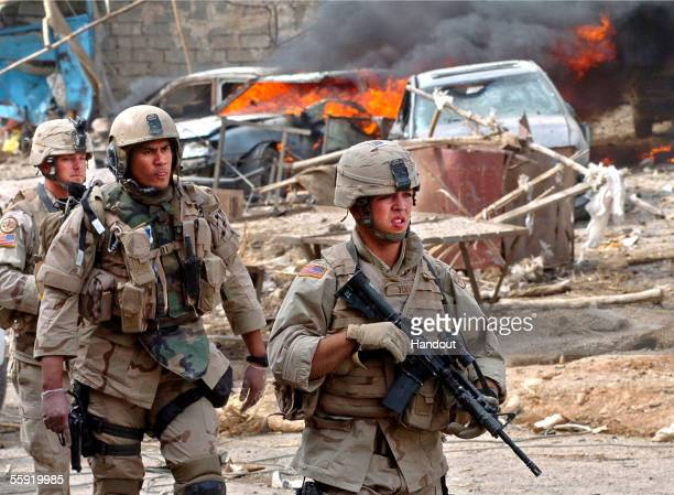 In this handout picture released by the US Army US soldiers patrol on October 11 2005 in the city of Tal Afar Iraq A suicide bomb attack killed 33...