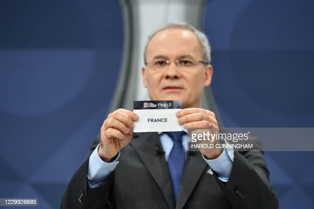 In this handout picture taken and made available by the UEFA on December 3, 2020 UEFA Deputy General Secretary Giorgio Marchetti draws out the card...