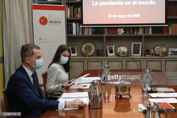In this handout provide by Casa de SM el Rey Spanish Royal Household The board members of the Elcano Royal Institute meet King Felipe of Spain and...