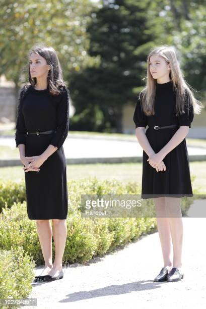 In this handout provide by Casa de S.M. El Rey Spanish Royal Household, Queen Letizia of Spain and Princess Sofia of Spain take a minute of silence...