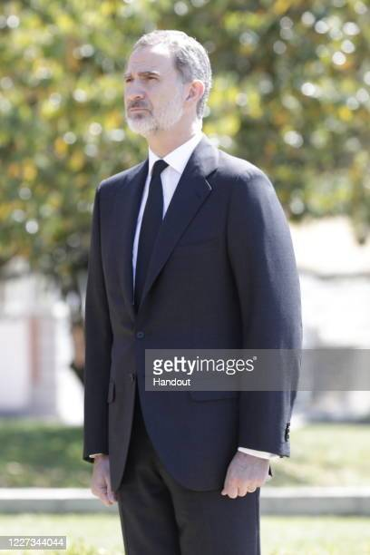In this handout provide by Casa de S.M. El Rey Spanish Royal Household, King Felipe VI of Spain takes a minute of silence for the COVID 19 victims at...
