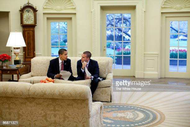 In this handout provide by the White House US President Barack Obama meets with the Director of Speechwriting Jon Favreau in the Oval Office of the...