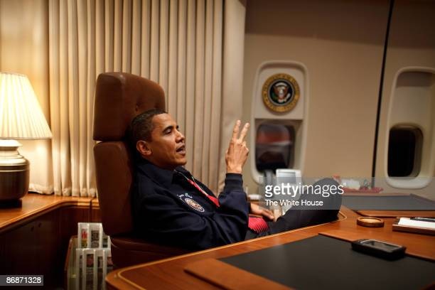 In this handout provide by the White House US President Barack Obama wears a AF1 jacket on his first flight aboard Air Force One from Andrews Air...