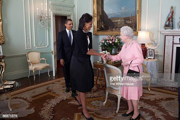 In this handout provide by the White House, U.S. President Barack Obama and First Lady Michelle Obama are welcomed by Her Majesty Queen Elizabeth II...