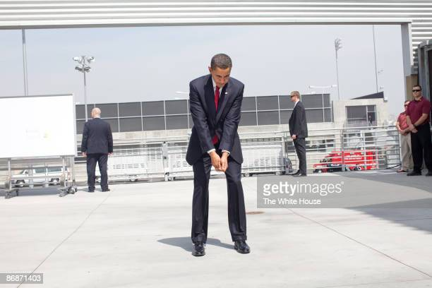 In this handout provide by the White House US President Barack Obama practices his golf swing at an outdoor hold prior to an event at the Miguel...