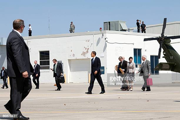 In this handout provide by the White House, U.S. President Barack Obama and White House staff members prepare to leave Des Moines Airport after a...