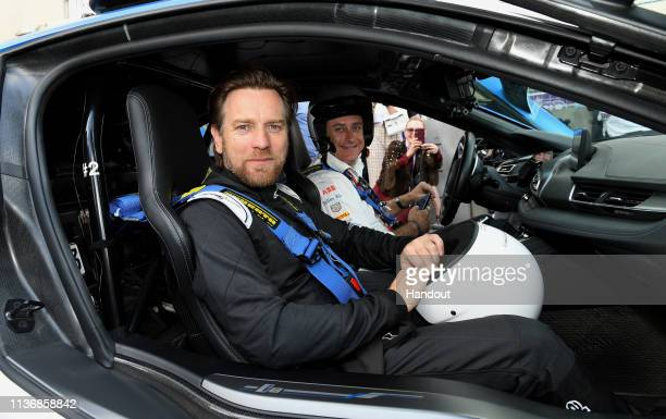 In this handout provided by ABB FIA Formula E Actor Ewan McGregor takes a ride in the BMW i8 Safety car with Alejandro Agag CEO Formula E during the...