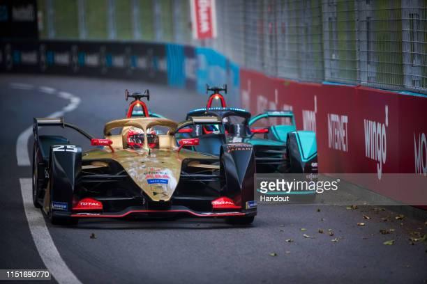 In this handout provided by ABB FIA Formula E, Jean-Eric Vergne , DS TECHEETAH, DS E-Tense FE19 battles with Mitch Evans , Panasonic Jaguar Racing,...