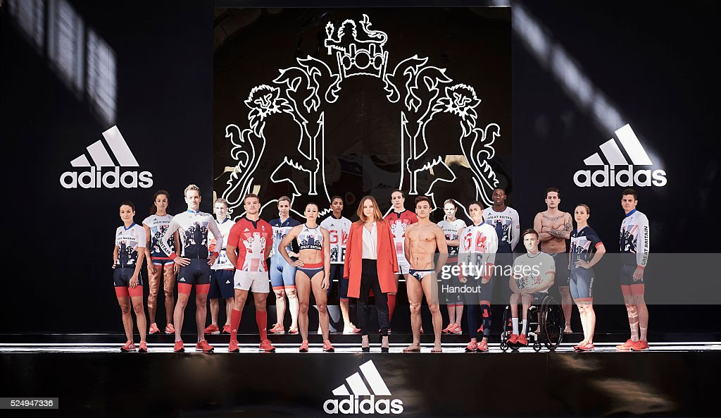 In this handout provided by adidas, Creative Director Stella McCartney joins Team GB and ParalympicsGB athletes to unveil the new adidas and Stella McCartney Team GB kit for Rio 2016 (L to R) Lizzie Armistead, Jodie Williams, Alistair Brownlee, Max Whitlock, Tom Mitchell, Becky James, Jessica Ennis-Hill, Laviai Nielsen, Stella McCartney, Emily Scarratt, Tom Daley, Lauren Steadman, Ojie Edoburun, Gordon Reid, Chris Walker-Hebborn, Laura Trott, Jonny Brownlee at Seymour Leisure Centre on April 27, 2016 in London, England.