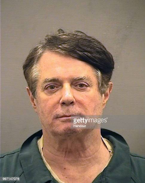 In this handout provided by Alexandria Sheriff's Office Paul Manafort poses for a mugshot photo at the Alexandria Detention Center in Alexandria...