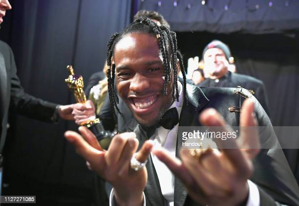 "In this handout provided by A.M.P.A.S., Actor Shameik Moore reacts backstage after winning the Best Animated Feature Film award for ""Spider-Man: Into..."