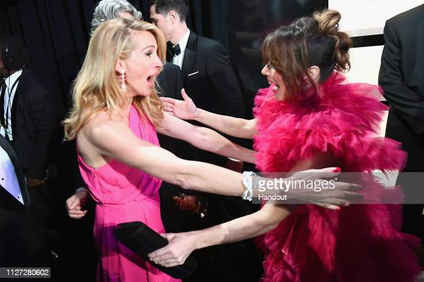 In this handout provided by AMPAS After 'Green Book' was awarded Best Picture Julia Roberts hugs Linda Cardellini backstage during the 91st Annual...