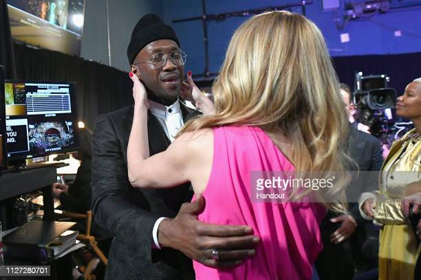 In this handout provided by AMPAS After 'Green Book' was awarded Best Picture Best Supporting Actor winner Mahershala Ali hugs Julia Roberts...