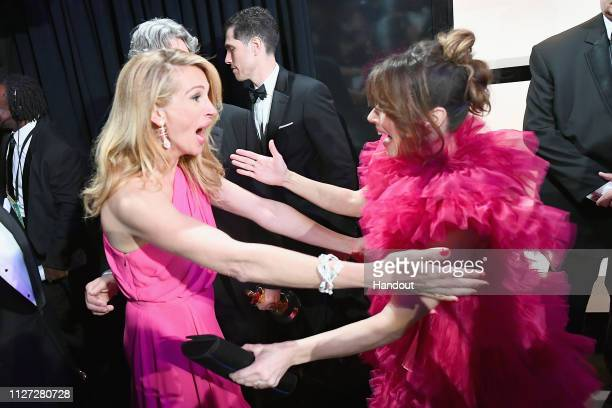 In this handout provided by AMPAS After 'Green Book' was awarded Best Picture presenter Julia Roberts poses with Linda Cardellini backstage during...