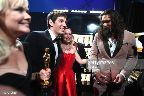 In this handout provided by AMPAS Alex Honnold and Sanni McCandless pose backstage after winning the Best Documentary Feature award for Free Solo...