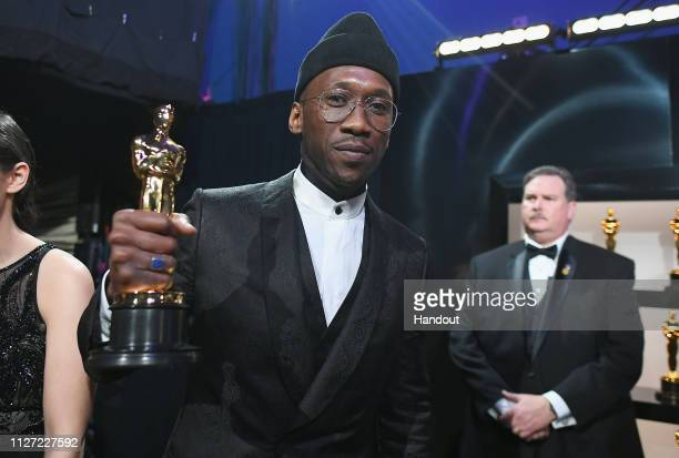 In this handout provided by A.M.P.A.S., Best Actor in a Supporting Role winner Mahershala Ali poses backstage during the 91st Annual Academy Awards...