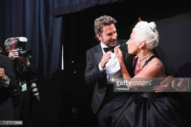 In this handout provided by AMPAS Bradley Cooper and Lady Gaga pose backstage during the 91st Annual Academy Awards at the Dolby Theatre on February...