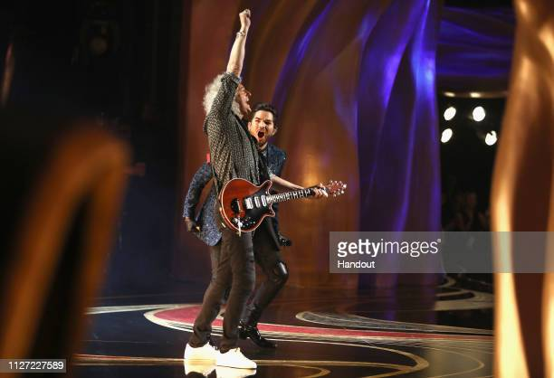 In this handout provided by AMPAS Brian May and Adam Lambert perform with Queen onstage during the 91st Annual Academy Awards at the Dolby Theatre on...